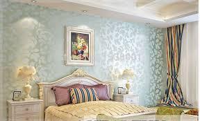 warm bedroom design. Delighful Bedroom ElegantNonwovenLightBlueLeafEmbossedWallpaper And Warm Bedroom Design