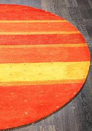 contemporary round rugs contemporary modern stripes orange gold wool round rug contemporary rugs nz