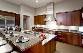 kitchen with european style cabinetry and raised granite breakfast bar