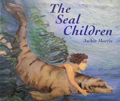 image of front cover of the seal children a boy swimming underwater with a seal