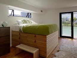 high platform beds with storage. Beautiful High High Platform Bed Floating House Master Bedroom On Beds With Storage HGTVcom