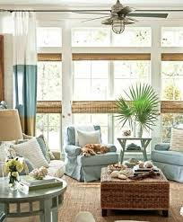 coastal casual living room with shiplap and bamboo blinds via remodelaholic casual living room