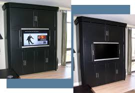 Even with the television off, this black-oiled lacquer finished murphy bed  system looks very elegant in Mrs. Norris's living room. This system is 71  wide, ...
