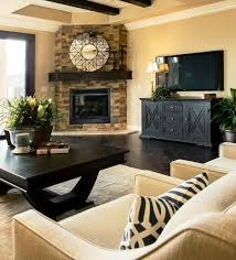 creative small living room decorating ideas in conjunction with a corner fireplace plus black cabinet tv stands and sofa also large coffee table and some