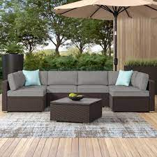 Wrought Studio Bozman 7 Piece Outdoor Patio Furniture Chocolate Brown Wicker Sofa W Dark Grey Cushions Coffee Table 2 Turquoise Pillows Incl Waterproof Cover Reviews Wayfair