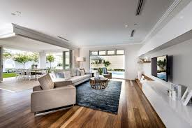 spotted gum floors grey white walls light fabric couch floating white timber tv unit