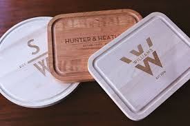 personalized wood or glass cutting boards add style and a chic look to your kitchen you can leave these monogrammed cutting boards out on your counter top