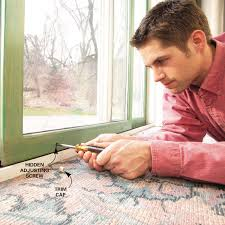 lift or lower the door on the track with a driver or allen wrench raise it just enough to clear the track and roll smoothly locate the two adjusting