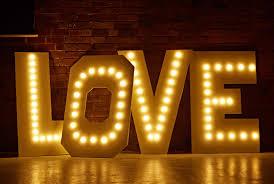 diy love marquee letter wedding lights using warm white festoon lights