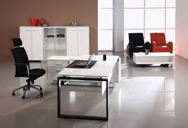 modern white office executive desk with black chair file cabinet and bookcase in office