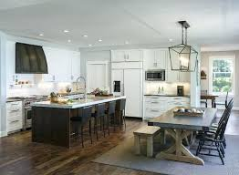 darlana linear chandelier transitional kitchen opens to dining room with linear chandelier and restoration hardware zinc top dining visual comfort darlana