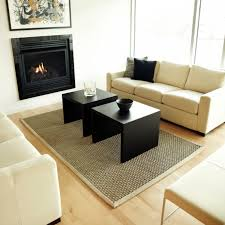 grey seagrass rug with wood coffee tables