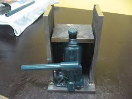 toe jack by taydin homemade toe jack constructed from steel plate and a bottle