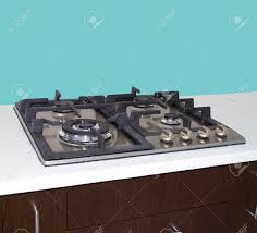Kitchen Stove Clean With Cyan Wall And White Table Top Granite