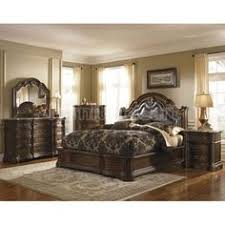 This Dark Cherry Stained Finish Ledelle Poster Bedroom Set Includes The 4 Poster  Bed And A 3 Drawer Nightstand. Both Have Elegant Carved Details Inu2026