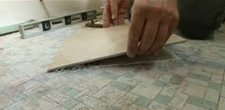 laying tile on a tile floor