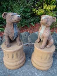 vintage matching pair large stone staffie dogs garden ornaments bronze plinths image 1