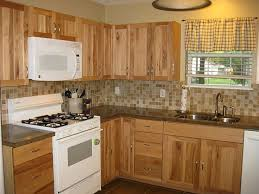 choose right backsplash for hickory cabinets with dark coutertops hickory kitchen cabinets with granite countertops like the coloration
