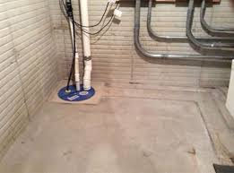 vapor barrier is installed over the tile and washed rock and new concrete is poured to return the floor to its original level