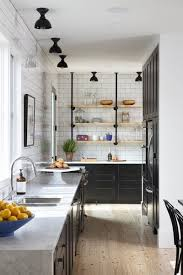 professionally painted black shaker style cabinets in this kitchen provide a strong contrast to the