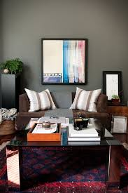red area rugs with contemporary living room and dark grey walls brown sofa dark gray walls glass top coffee table first apartment