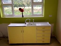 kitchen sinks metal kitchen sink cabinet unit light yellow and