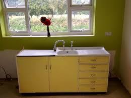 kitchen sinks metal kitchen sink cabinet unit light yellow and