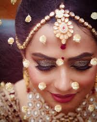indian bridal makeup look with full glitter eyelids with pink lips