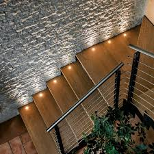 led stair lighting wooden steps stone wall