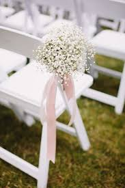wedding aisle flowers. A beautiful Hayley Paige bride for a pretty white blush June