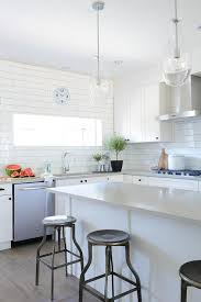 light gray quartz countertops astonish white kitchen backsplash tiles go up to ceiling transitional decorating ideas