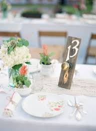 use door knobs to create decorative table numbers for your wedding