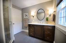 Here is a closer looks at the vanity wall vignette. We chose a dark stain  for the cabinetry to complement the white stone-top.