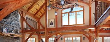 timber frames work well in an open floor plan the decor in this house evokes
