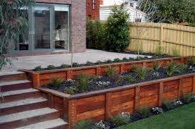 Small Picture build a retaining wall image of landscape timber retaining wall
