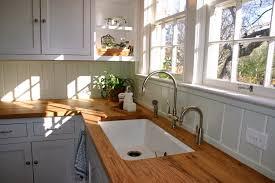 kitchen wood countertops orange pendant bar lighting cherry stool modern design ideas laminate flooring white