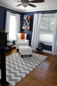 Boy's room - I like the orange accents! I have always wanted a navy room