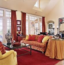 when starting with a red carpet other red decor ideas like throw pillows and curtains bring a lively feeling to your living room