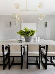 dining room of a glamorous home in scarsdale ny designed by tamara magel via