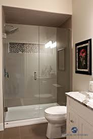 small bathroom with walk in shower glass doors fibreglass base mosaic tile niche