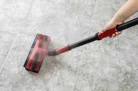 cleaning tile floor with steam mop