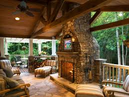 buckhead covered cedar deck with tv stone fireplace by paces construction co atlanta