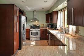 contemporary kitchen with cherry cabinets green wall paint and ivory fantasy granite counters