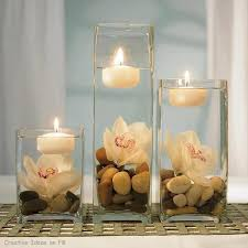 Floating Candles in Glass Vases  orchid in vase with floating candle