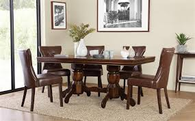 sworth dark wood extending dining table with 4 bewley club brown chairs