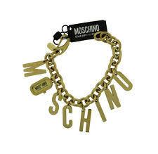 moschino watch moschino mw0002 women s analog letter charms gold tone bangle style watch