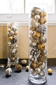 Fabulous christmas decoration ideas using candles Diy Fill Cylinders With Ornaments Christmas Decorating Ideas Southern Living 100 Fresh Christmas Decorating Ideas Southern Living