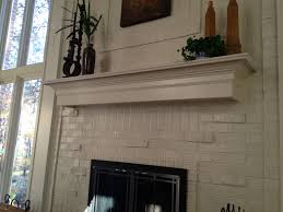 mantel ideas for brick fireplace white painted brick and white floating mantel fireplace