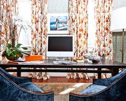 orange home office. example of an eclectic freestanding desk medium tone wood floor home office design in charleston orange