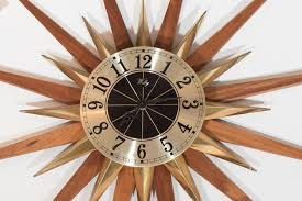 mid century modern starburst wall clock by welby division elgin national watch company for